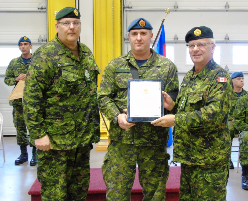 MCpl Wade receiving CMEA Commendation from Col Comdt Steve Irwin and Branch CWO Ron Swift