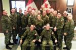 Colonel Martin Gros-Jean, Comd CF RP Ops Gp (seated, left) and Chief Warrant Officer Gord Aitken, FCWO (seated, right) surrounded by the Regional command teams and CF HQ staff.