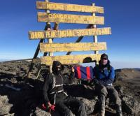 Major Mark Phillips and Ed Batchelor, Major (Ret'd) proudly holding the CME Flag at the summit of Mount Kilimanjaro - 21 July 2017